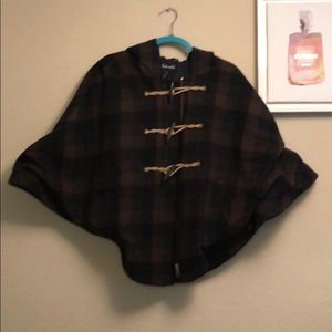 Only a few hundred made! Plaid cape
